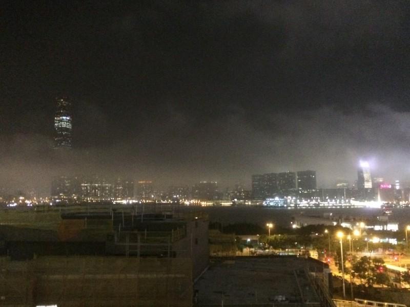 Nighttime in Hong Kong: A city bathing in clouds